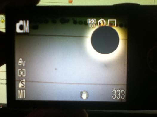 tache noire sur écran appareil photo numérique